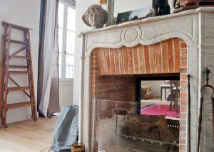 Travaux de rénovation et installation d'une cheminée double face